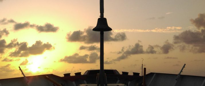 Ship's bell of Fugro Gauss at sun rise in Gulf of Mexico